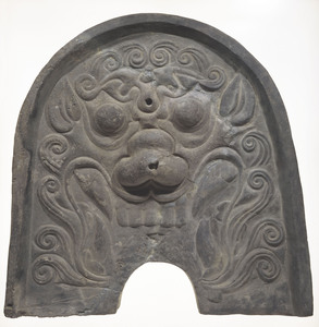 Roof ridge-ornament with goblin face design (Excavated presumably from a kiln site of Nakayama, Nara)