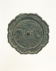 Eight-lobed mirror with design of auspicious flowers and two pheonixes (Excavated from sutra mound at Kimpu-sen, Nara)